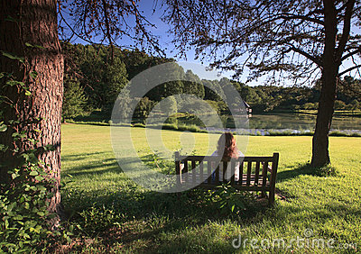 Park Landscape:  Woman Relaxing on Bench in Shade