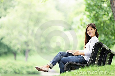 Park woman reading on bench