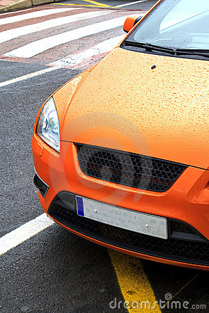 Parked orange sports car