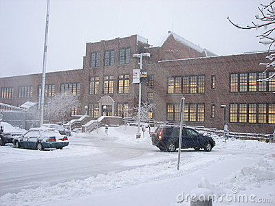 Parking lot and Admin building in heavy Snow Storm Editorial Stock Image