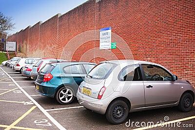 Parking lot near brick wall Editorial Stock Photo