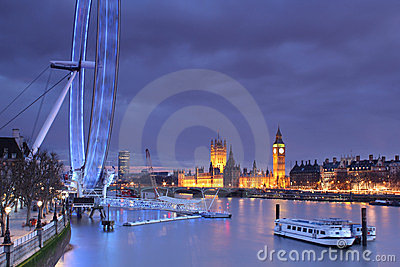 Parliament, Big Ben and the London Eye at dusk Editorial Image