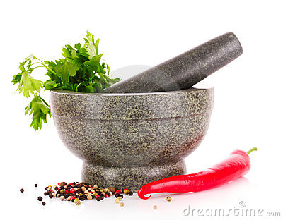Parsley in amortar gray and red pepper isolated Stock Photo