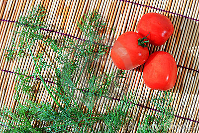 Parsley and tomato on bamboo plate