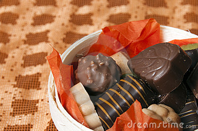Part of Basket of chocolate on orange background