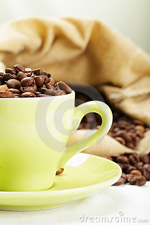 Part of cup with coffee beans
