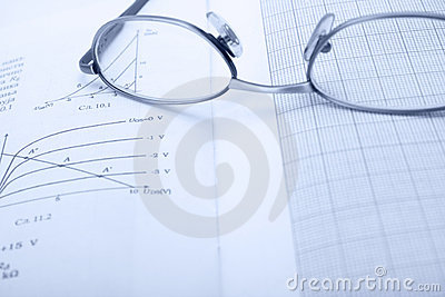 Part of eyeglasses and paper