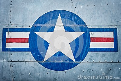 Military plane with star and stripe sign.