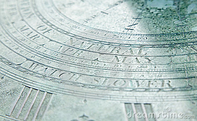Part of an old sundial with word