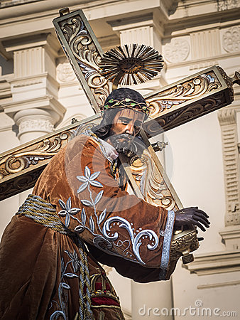 Statue of Jesus bearing cross Editorial Stock Photo