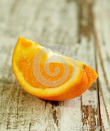 part of orange on wooden