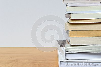 Part of paper book stack on wood table