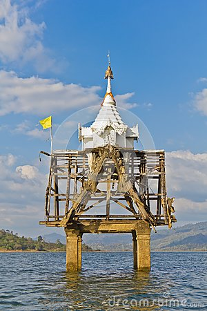 Part of Thai church bell tower expose in the river