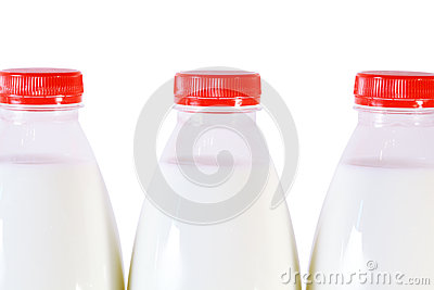 Part of three bottles of milk with cap isolated