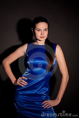 Part of woman in blue dress