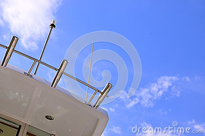 Part of yacht body under blue sky