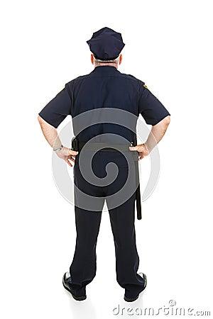 Parte traseira cheia do corpo do oficial de polícia
