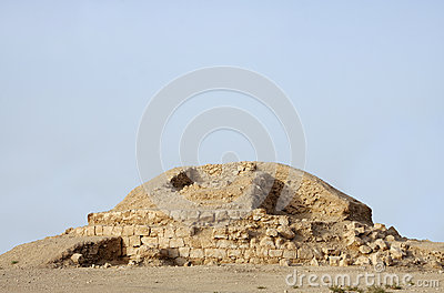 Partial excavated burial mound in Saar village