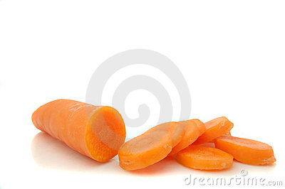 Partially sliced carrot.