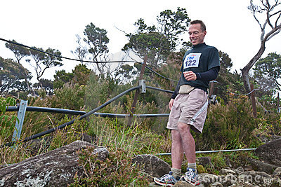 Participant running down Mt Kinabalu Editorial Photo