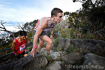 Participants climbing up Mt Kinabalu in race Editorial Image
