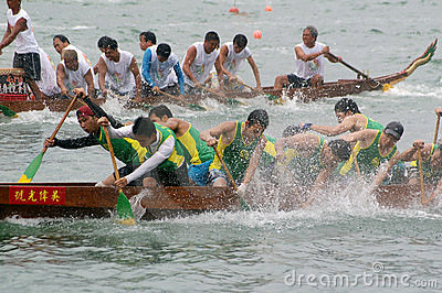 Participants paddle their dragon boats Editorial Stock Photo