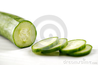 Partly sliced organic cucumber