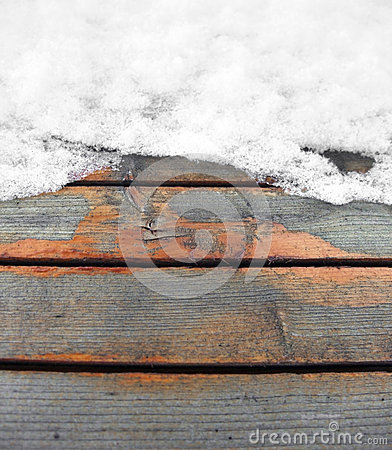 Partly snow covered wooden boards