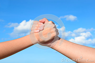 Partner hand between a man and a woman
