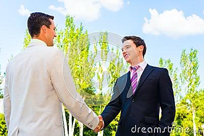 Partner het schudden handen