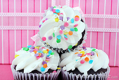 Party cupcakes in front of gift
