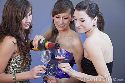 Party girls drinking champagne