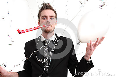 Party guy holding a balloon