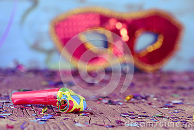 Party horn, confetti and carnival mask