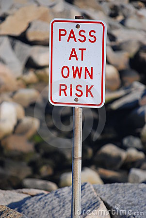 Pass at Own Risk Signage