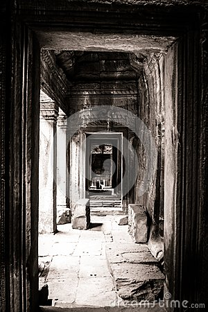 Passage view of a face in Bayon, Angkor, Cambodia
