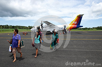 Passangers getting out of Pacific Sun airplane, Labasa airport, Editorial Photo