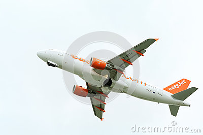 Passenger airplane takeoff from active runway Editorial Stock Photo