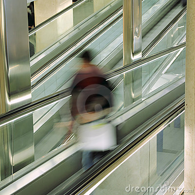 Passenger on escalator at at the airport