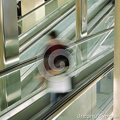 Passenger on escalator at at the airport