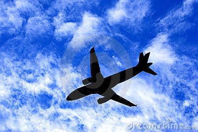 Passenger Jet Plane Silhouette on Cloudy Blue Sky