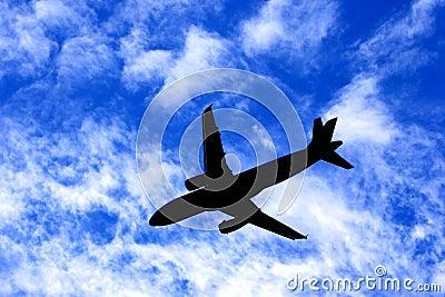 Passenger Jet Plane Silhouette on Cloudy Blue Sky