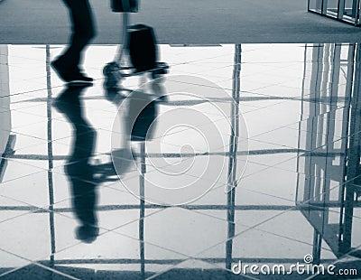 Passenger (Man) rushing through airport terminal