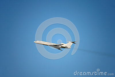 A passenger plane flying in the clear sky