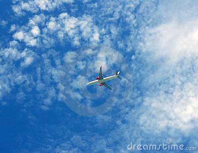Passenger plane flying in sky background