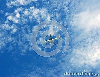 Passenger plane flying in sky background