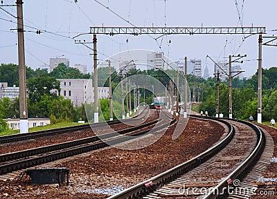 Passenger train arriving on station
