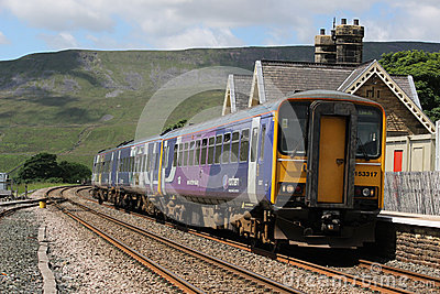 Passenger train leaving Ribblehead station Editorial Stock Photo