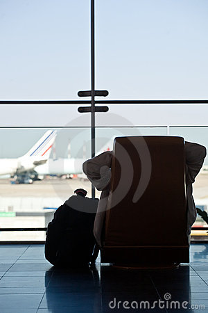 Passenger waiting for his flight Editorial Photography