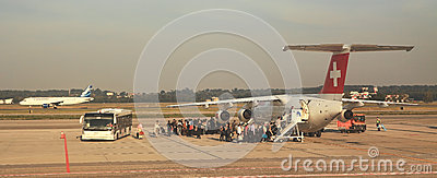 Passengers Boarding At Malpensa Airport. Royalty Free Stock Photo - Image: 25902175